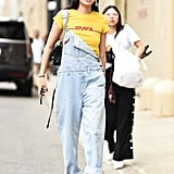 Wear Your Denim Overalls Open on 1 Side to Show Off a Graphic Tee
