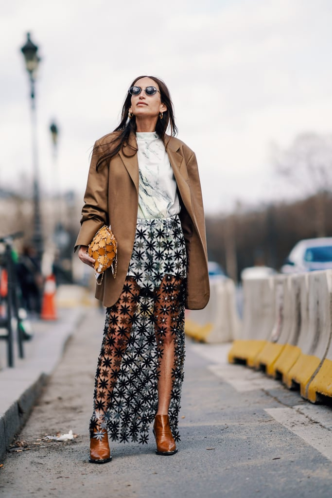 Looking for a way to show off some skin? Style your sheer skirt with a brown blazer for a put together look.