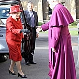 Looking sharp in red, the queen greeted the Archbishop of Canterbury before a multifaith reception for the Diamond Jubilee in February.