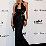 We didn't expect to see Sharon Stone at MFW, but the actress made quite an entrance in a sexy, key-hole cut Roberto Cavalli gown at amfAR.