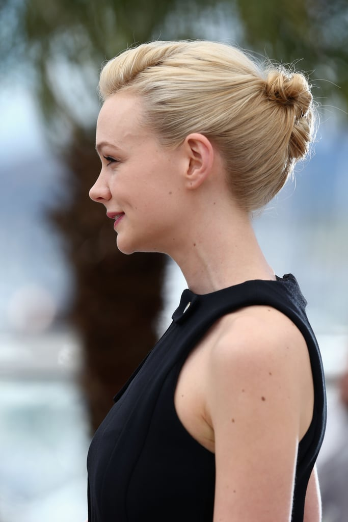 At the photo call earlier in the day, Carey debuted her intricate up 'do.
