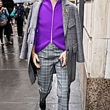 Olivia remixed a plaid Tibi suit with a sporty and bright Tibi zip-up while heading to the show in NYC.