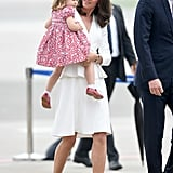Kate looking on at an adorable Princess Charlotte.
