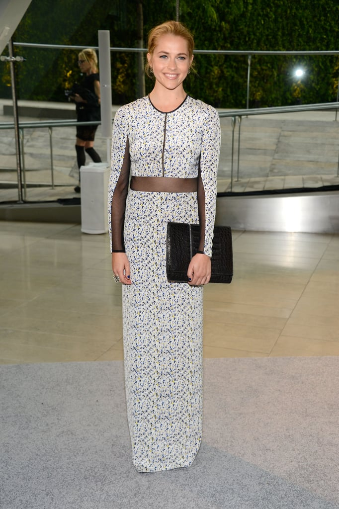 Teresa Palmer was statuesque in her sheer printed Yigal Azrouel gown, which she accessorised with an oversized clutch.