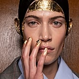 Gold Leaf  Covered Faces at Preen by Thornton Bregazzi Autumn 2020