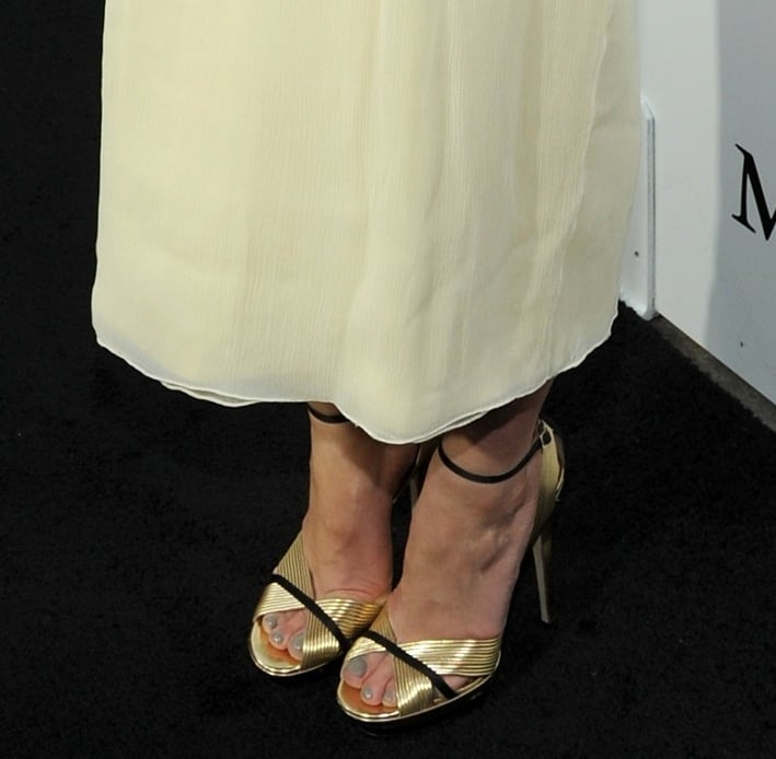 At the Women in Film event, Mary Elizabeth Winstead wore a creamy dress with black-and-gold Jimmy Choo sandals.