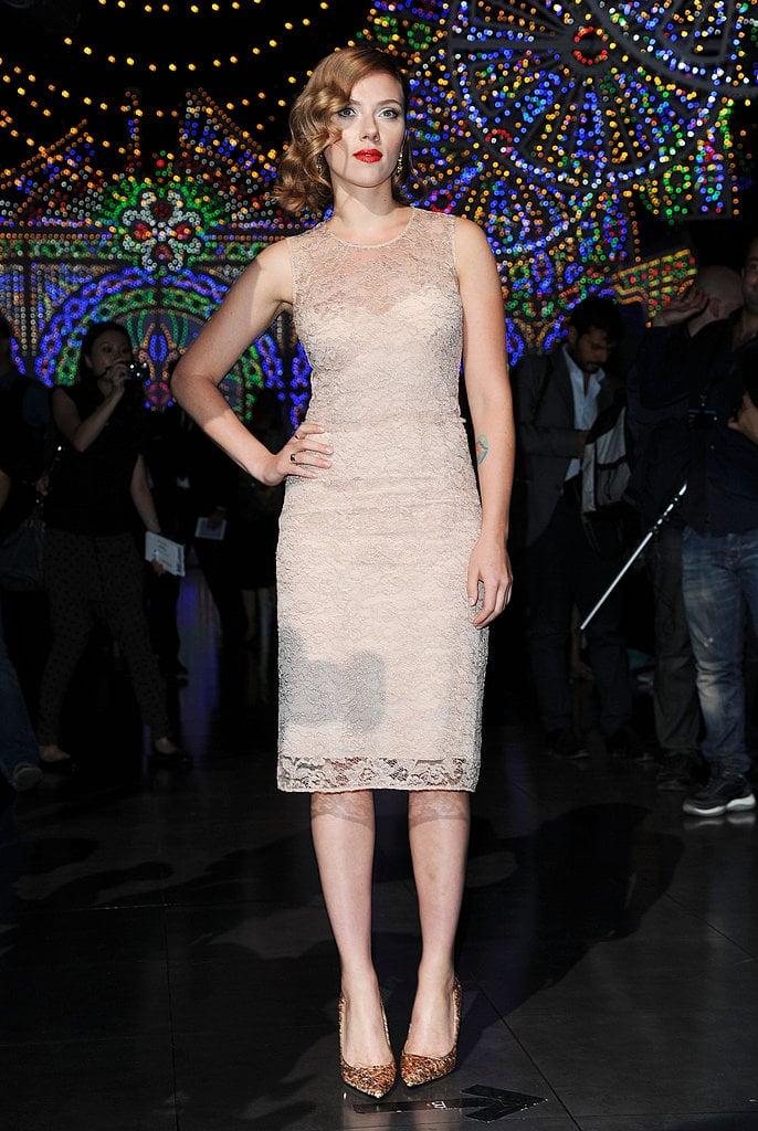 Scarlett Johansson wore a Dolce & Gabbana lace sheath dress to the brand's runway show.