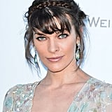 Milla Jovovich wore aqua-colored gem earrings.