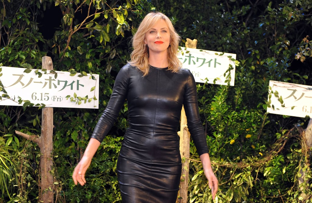 A zoomed-in look at Charlize's The Row dress in Tokyo — notice the slick ruched details at the waist.