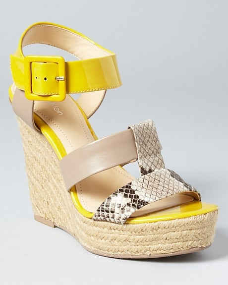 A wedge with neon and sexy snakeskin? Consider us sold.  Calvin Klein Ellison Espadrille Wedges  ($119)