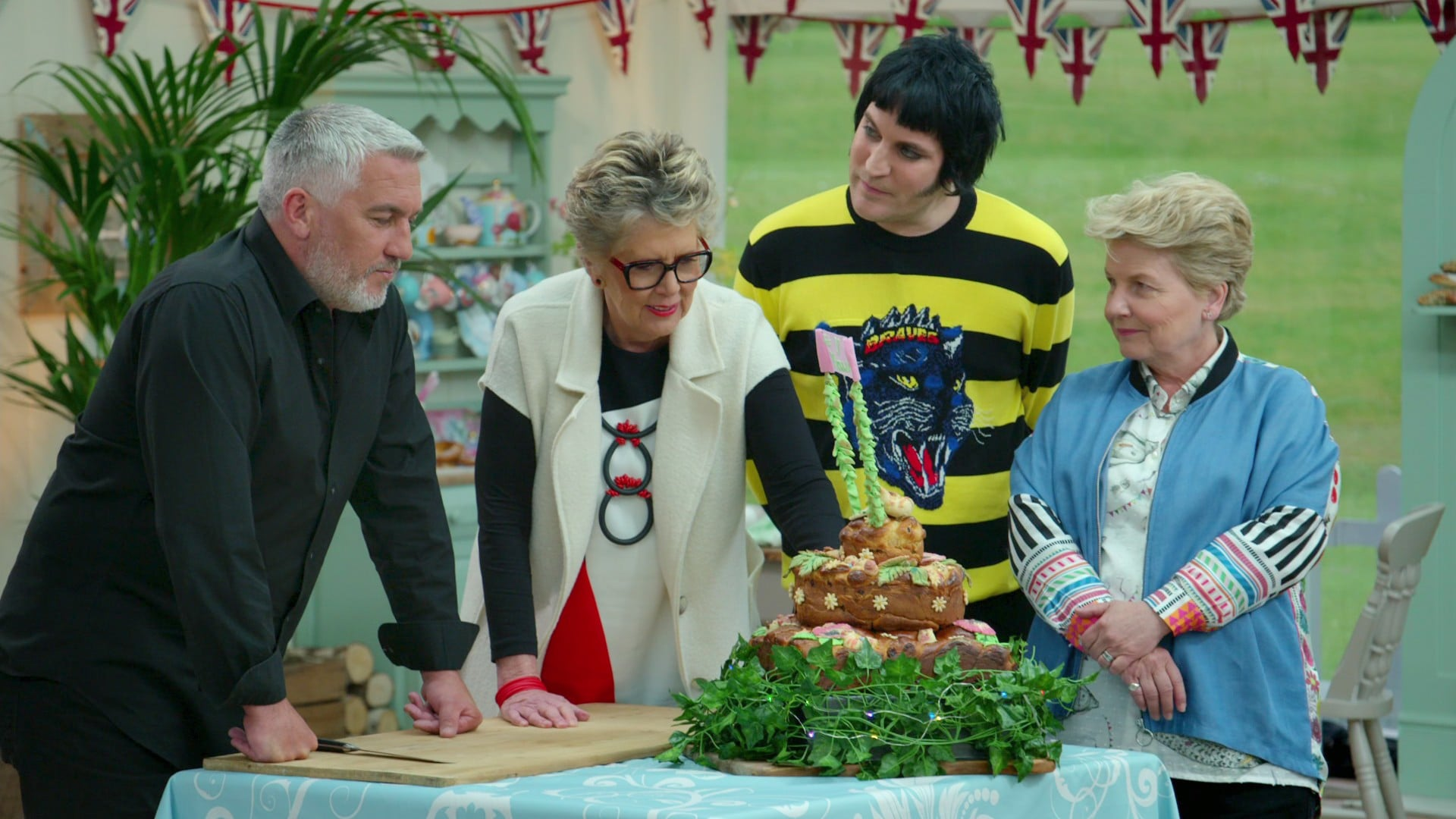 THE GREAT BRITISH BAKE OFF, (aka THE GREAT BRITISH BAKING SHOW), from left: judges Paul Hollywood, Prue Leith, presenters Noel Fielding, Sandi Toksvig, 'Bread', (Season 9, ep. 903, aired in the US on Nov. 9, 2018). photo: Netflix / Courtesy Everett Collection