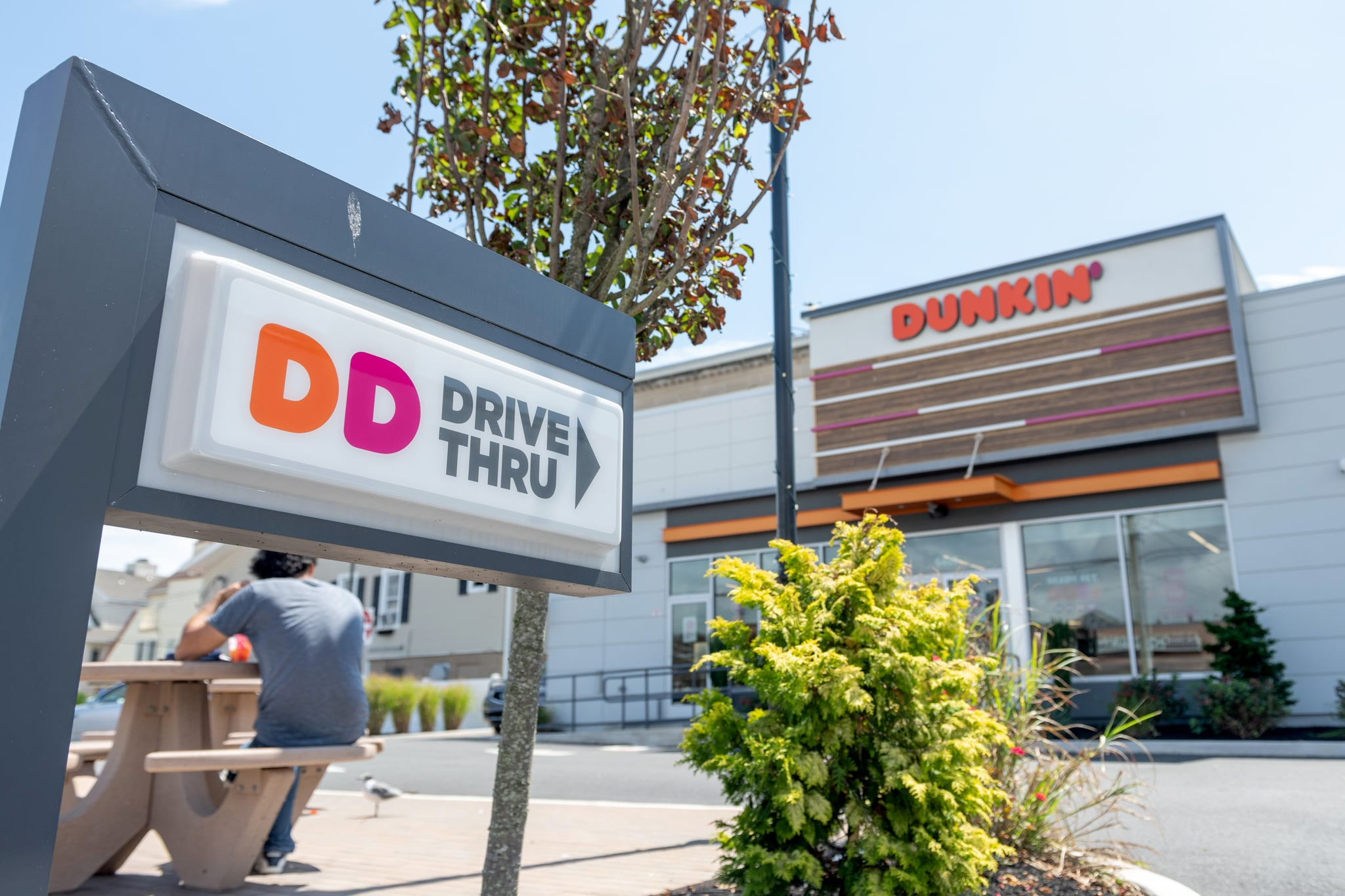 VENTNOR CITY, NEW JERSEY - AUGUST 14: A view of a Dunkin' Donuts drive through sign is seen as the state of New Jersey continues Stage 2 of re-opening following restrictions imposed to slow the spread of coronavirus on August 14, 2020 in Ventnor City, New Jersey. Stage 2, allows moderate-risk activities to resume which includes pools, youth day camps and certain sports practices.  (Photo by Alexi Rosenfeld/Getty Images)
