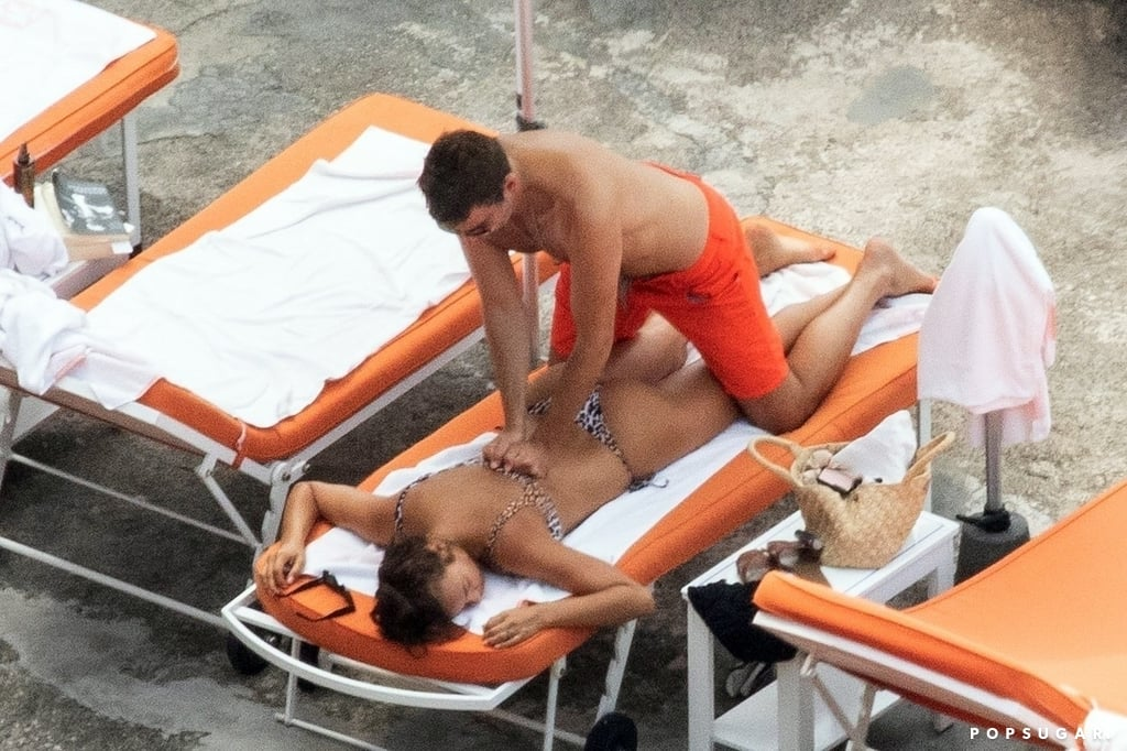 Is it hot in here? Oh, it's actually just Bradley Cooper and Irina Shayk. The couple are currently enjoying a romantic getaway in Positano, Italy, and on Friday, they were spotted frolicking on the beach. Bradley and Irina looked so in love as they swam in the ocean, worked on their tans, and shared a few laughs together. At one point, Bradley even gave a Irina a back massage — how sweet is that? The 32-year-old model put her incredible figure on display in a sexy leopard bikini, while the 43-year-old actor went shirtless and showed off his muscles.  Irina and Bradley have been going strong since 2015 and are parents to 1-year-old daughter Lea. And if their PDA-filled beach day looks familiar, there's a good reason. Back in August 2015 (yep, exactly three years ago), the pair put their newfound romance on display while vacationing on the Amalfi Coast. Bradley even wore the same orange swim trunks! Perhaps Bradley and Irina felt like taking a walk down memory lane?       Related:                                                                                                           You'll Need to Seriously Cool Off After Scrolling Through These Sexy Beach PDA Pictures