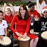 She showed off her sapphire engagement ring as she played the drums.