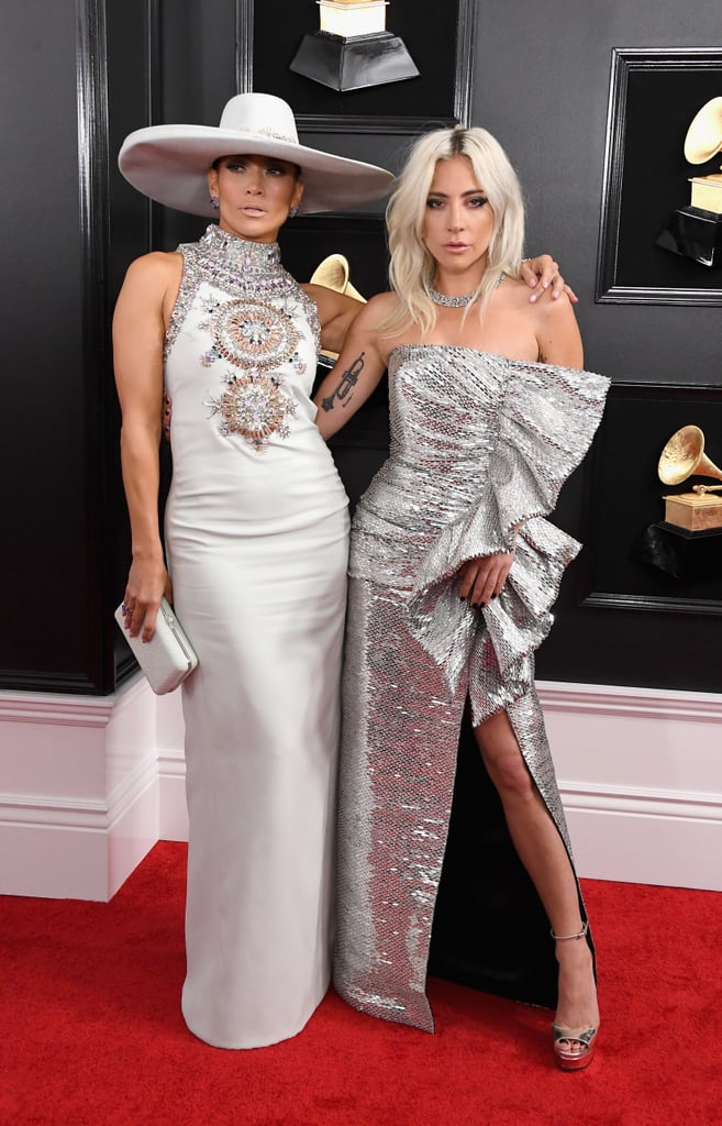 "What's better than one powerhouse celebrity wearing a pair of stunning shoes? How about two powerhouse celebrities wearing the same pair, like Lady Gaga and Jennifer Lopez? The incredible vocalists attended the 2019 Grammys on Feb. 10 in completely different dresses, but they chose the same pair of Jimmy Choo ""Max"" platform sandals for the award show. Great minds think alike! J Lo went for a white, straight-off-the-runway Ralph & Russo gown while Gaga opted for a silver Celine number. In each case, the metallic heels complemented the entirely different dresses. The dynamic duo met up on the red carpet, and while we can't be sure they made the Jimmy Choo connection, they clearly had fun together. Keep reading to see their outfits in full, and live vicariously through their fashionable friendship.       Related:                                                                                                           Lady Gaga, Ariana Grande, and Everyone Else Who's Already Won a Grammy This Year"
