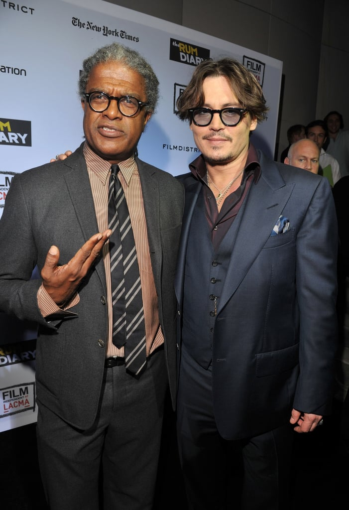 Johnny Depp posed with LACMA curator Elvis Mitchell at The Rum Diary premiere.