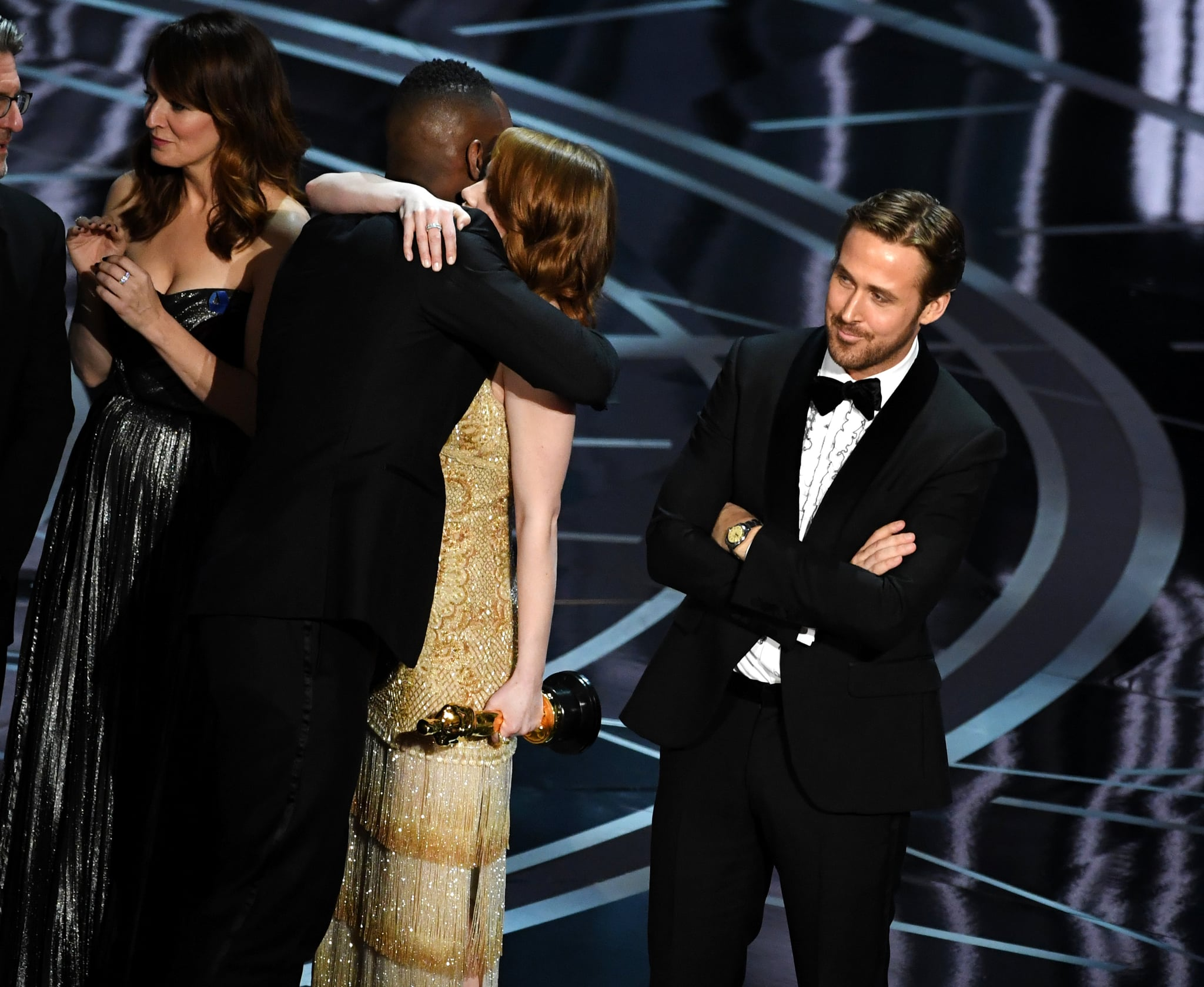 HOLLYWOOD, CA - FEBRUARY 26:  'Moonlight' actor Mahershala Ali hugs Emma Stone after it was discovered 'La La Land' was mistakenly announced as Best Picture onstage during the 89th Annual Academy Awards at Hollywood & Highland Centre on February 26, 2017 in Hollywood, California.  (Photo by Kevin Winter/Getty Images)