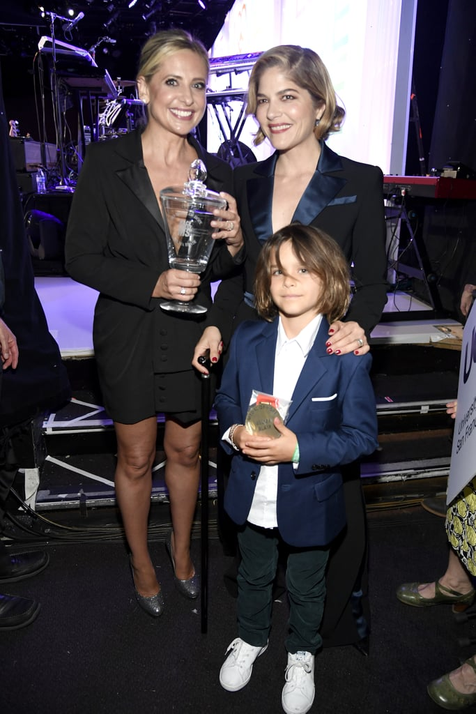 """Selma Blair, 46, was honored at the annual Race to Erase MS event in Beverly Hills on Friday night. At the gathering, the actress — who revealed she was diagnosed with multiple sclerosis in October – received support from 7-year-old son Arthur and best friend Sarah Michelle Gellar. The three gathered on the orange carpet and posed together for some adorable snapshots upon their arrival. Selma stunned in a two-piece suit as Arthur wore a blazer with dark pants and Sarah rocked a sophisticated all-black ensemble.  Selma appeared to be in high spirits as she knelt beside Arthur — who's a spitting image of her and his father, Jason Bleick — and flashed a smile at cameras. She and Sarah also shared laughs and embraces before heading into the event. Later, Arthur and Sarah joined Selma on stage as she spoke to guests to raise awareness about MS and help the organization, Race to Erase MS, find a cure for the disease.  Selma and Sarah's friendship goes back over 20 years ago to when they costarred in 1999's Cruel Intentions. In February, they celebrated their longstanding relationship as Selma opened up about how supportive Sarah has been throughout her battle with MS. """"She tucked me in and brought me dinner and loved me up. I woke with so much love for #sarahmichellegellar,"""" Selma wrote on Instagram. """"She took me under her wing, and today is no different. I am so in love with my angel of a friend."""" Related: Selma Blair's First Interview About Life With Multiple Sclerosis Should Be Required Viewing"""
