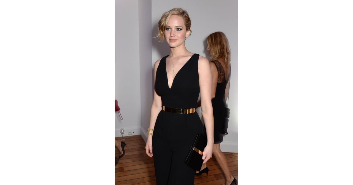 Jennifer Lawrence Wore A Black Dress With Gold Accessories