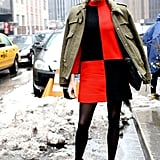 If mucky, muddy streets and sidewalks equal zero chance of trotting out your fancy heels, use your clothing to really make a statement.