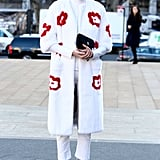 A sweet-meets-quirky Prada coat supplied the statement factor in this white-on-white style.