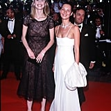 Kate wears a slinky white spaghetti-strap gown to Cannes Film Festival in 1998, but while it's sexy on top, the hem is long and quite demure. She poses alongside fellow '90s super, Claudia Schiffer.
