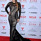 While taking the red carpet again, Eva Longoria showed off an onyx mermaid gown by Romona Keveza featuring sheer long sleeves and a dramatic train.