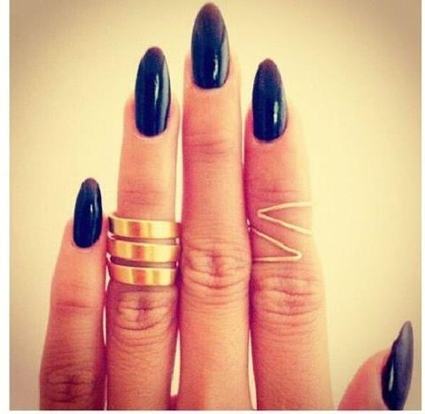 By now you know we love to check out Pinterest for inspiration on all things beauty, but one of our favourite things to look at are the nails, especially all the dark, Winter manicures that are bang on trend. Yes, we love bold colours to brighten up the season, but it's also nice to go dark and mysterious. First up, our favourite is black. It's classy, works with almost every outfit and always looks super-shiny, too. However, don't think it's your only option. There's also a swag of different shapes — from almond talons to short and squoval (square oval, of course), and colours — charcoal, navy, black and burgundy. Then there are all the different textures — from glitter to matte, shine and a mixture of both (accent nails, we're looking at you). So scroll down and get inspired to master a new manicure this season.