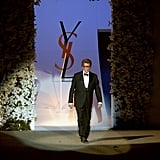 Yves Saint Laurent walked down the catwalk to salute the crowd after his last-ever haute couture show in 2002.