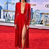 Matching the red carpet in a velvet Calvin Klein by Appointment dress. The red ankle-length dress featured a thigh-high slit and plunging neckline.