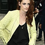 Kristen Stewart wore a neon leather jacket to the Balenciaga show for Paris Fashion Week.