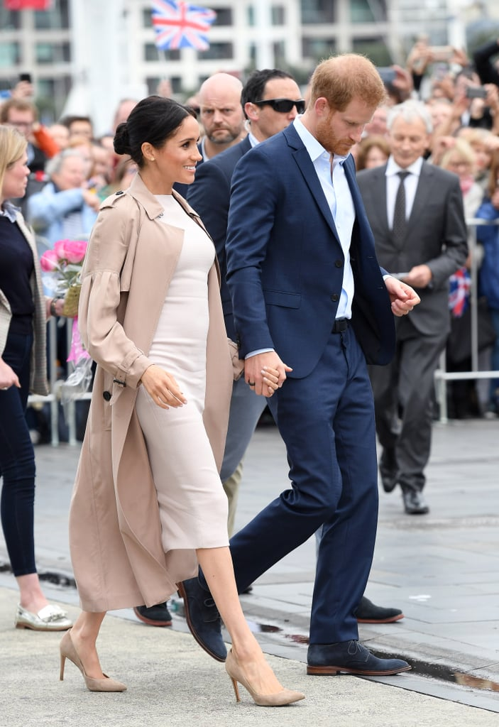 Meghan left her Burberry trench coat undone in New Zealand in 2018, showing off a Brandon Maxwell sheath underneath, complete with Stuart Weitzman pumps.