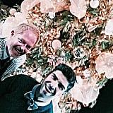 Jesse Tyler Ferguson took a sweet snap by the tree with Justin Mikita.