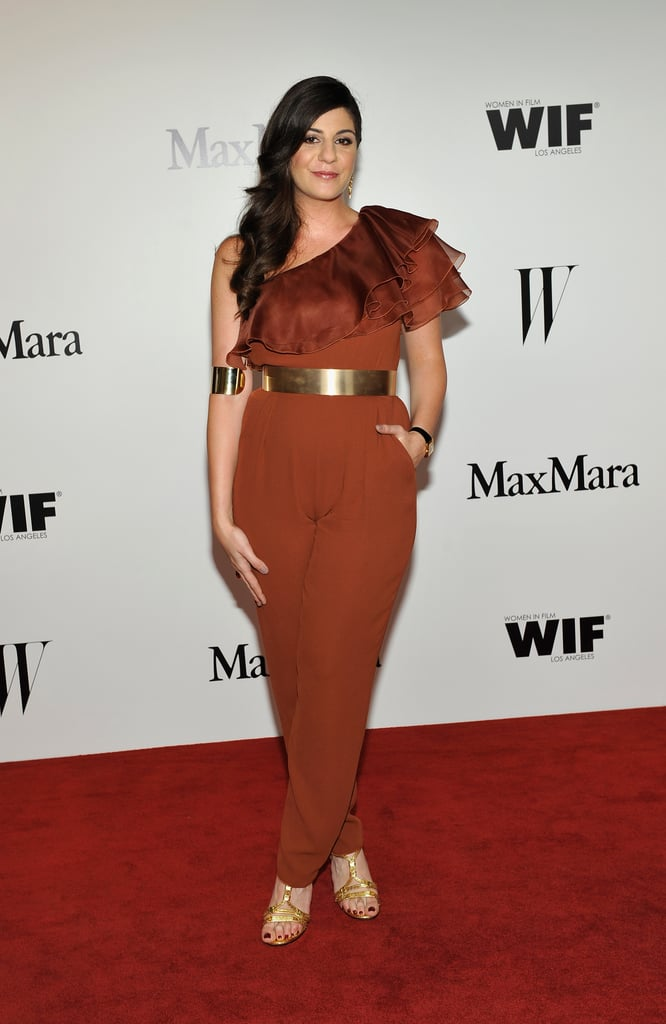 Max Mara's Maria Giulia Maramotti chose a brown silk and chiffon ruffled one-shoulder jumpsuit from the label for a '70s-sophiciate feel. A metallic belt and sandals furthered the vibe.