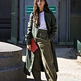 Take the utilitarian trend for a spin by pairing a white tee with army-green separates and pumps.