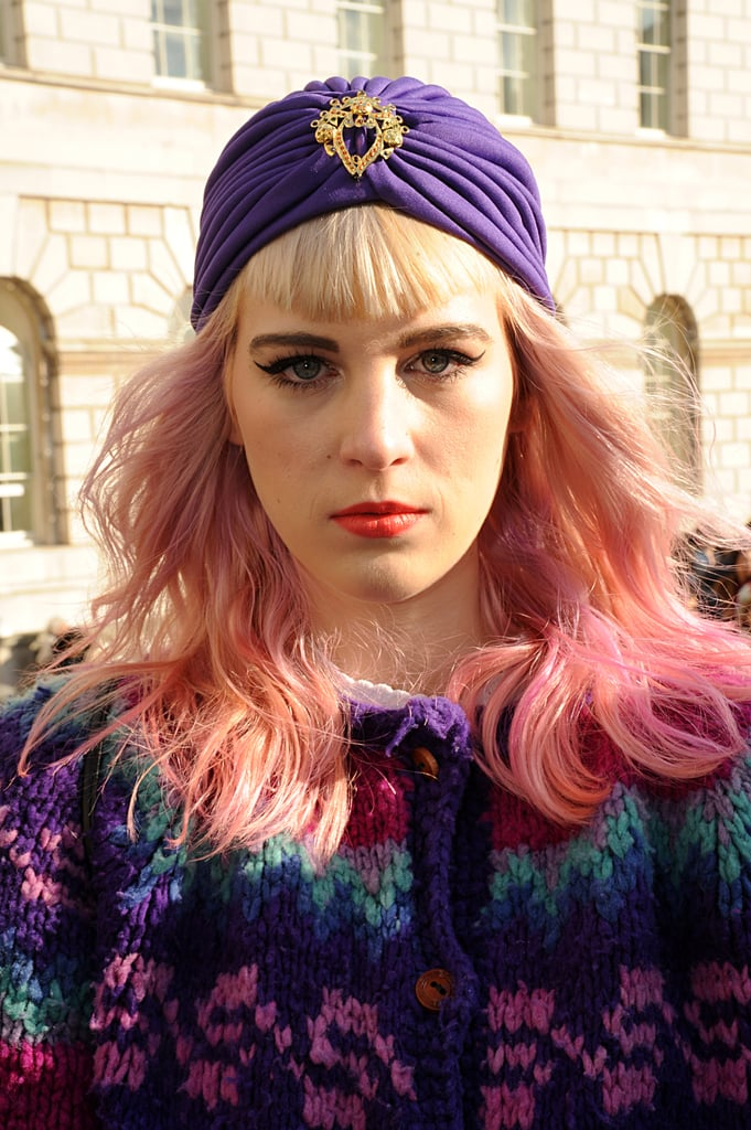 This fashion student showed off her colorful side with an ombré dye job, punchy lipstick hue, and aubergine turban.