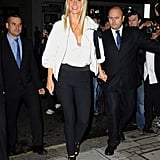 Gwyneth Paltrow headed to Stella McCartney in skinny black pants and chic white on top for London's FNO on Wednesday.