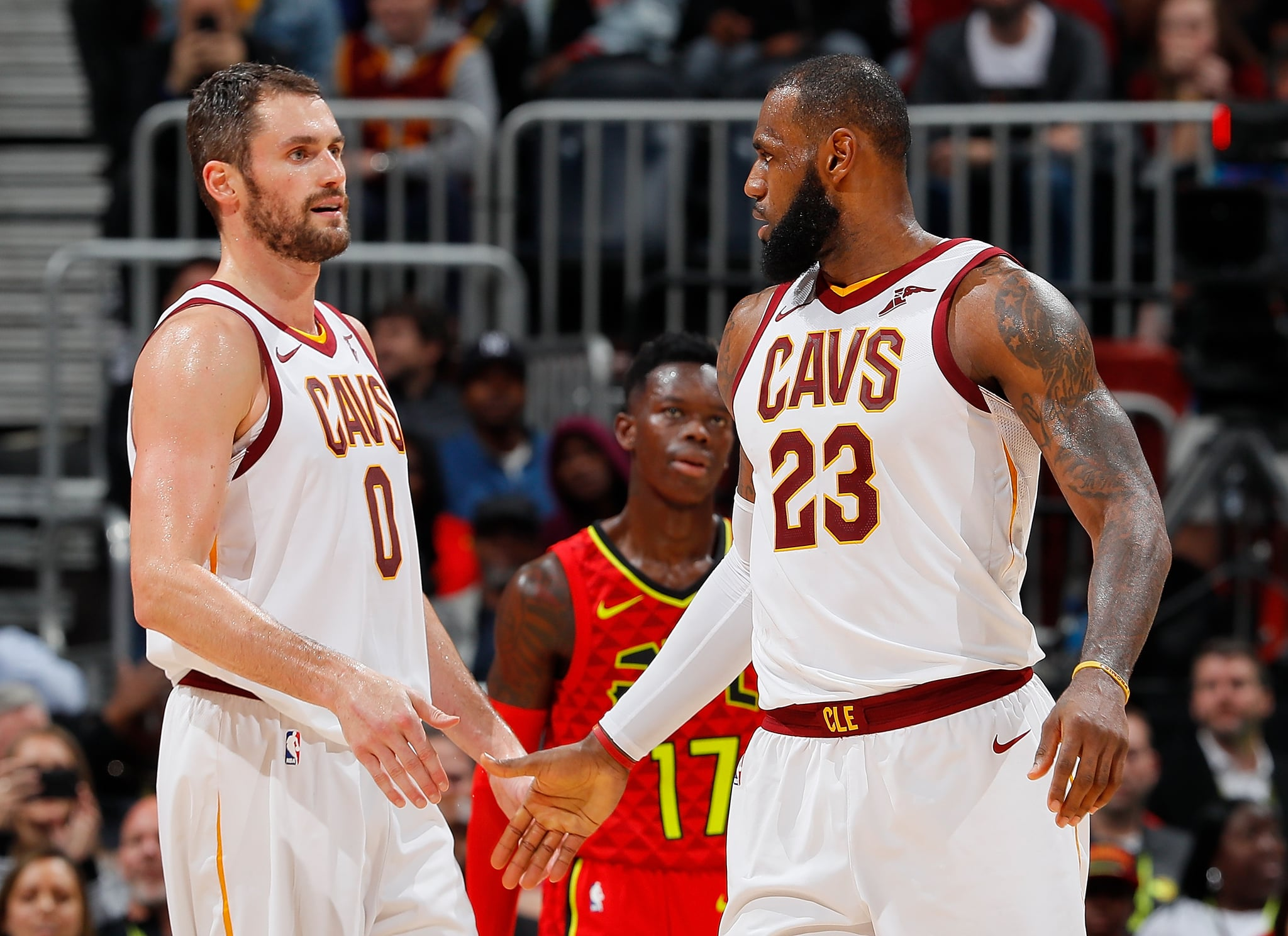 ATLANTA, GA - NOVEMBER 30:  LeBron James #23 of the Cleveland Cavaliers reacts with Kevin Love #0 after drawing a foul against the Atlanta Hawks at Philips Arena on November 30, 2017 in Atlanta, Georgia.  NOTE TO USER: User expressly acknowledges and agrees that, by downloading and or using this photograph, User is consenting to the terms and conditions of the Getty Images Licence Agreement.  (Photo by Kevin C. Cox/Getty Images)