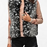 If you're looking for something a little less typical, we suggest this Pins and Needles Faux Fur Vest ($79) for its cool snow leopard effect.