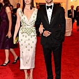 Jessica Biel looked stunning in a silk dress with green beading accompanied by Justin Timberlake at the Met Gala together.