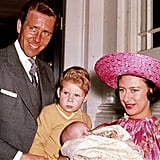 Princess Margaret held her youngest child Lady Sarah as her older child David, Viscount Linley, looked on.