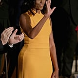 Michelle Obama Showed Off Her Toned Arms at the State of the Union in a Marigold Sleeveless Design
