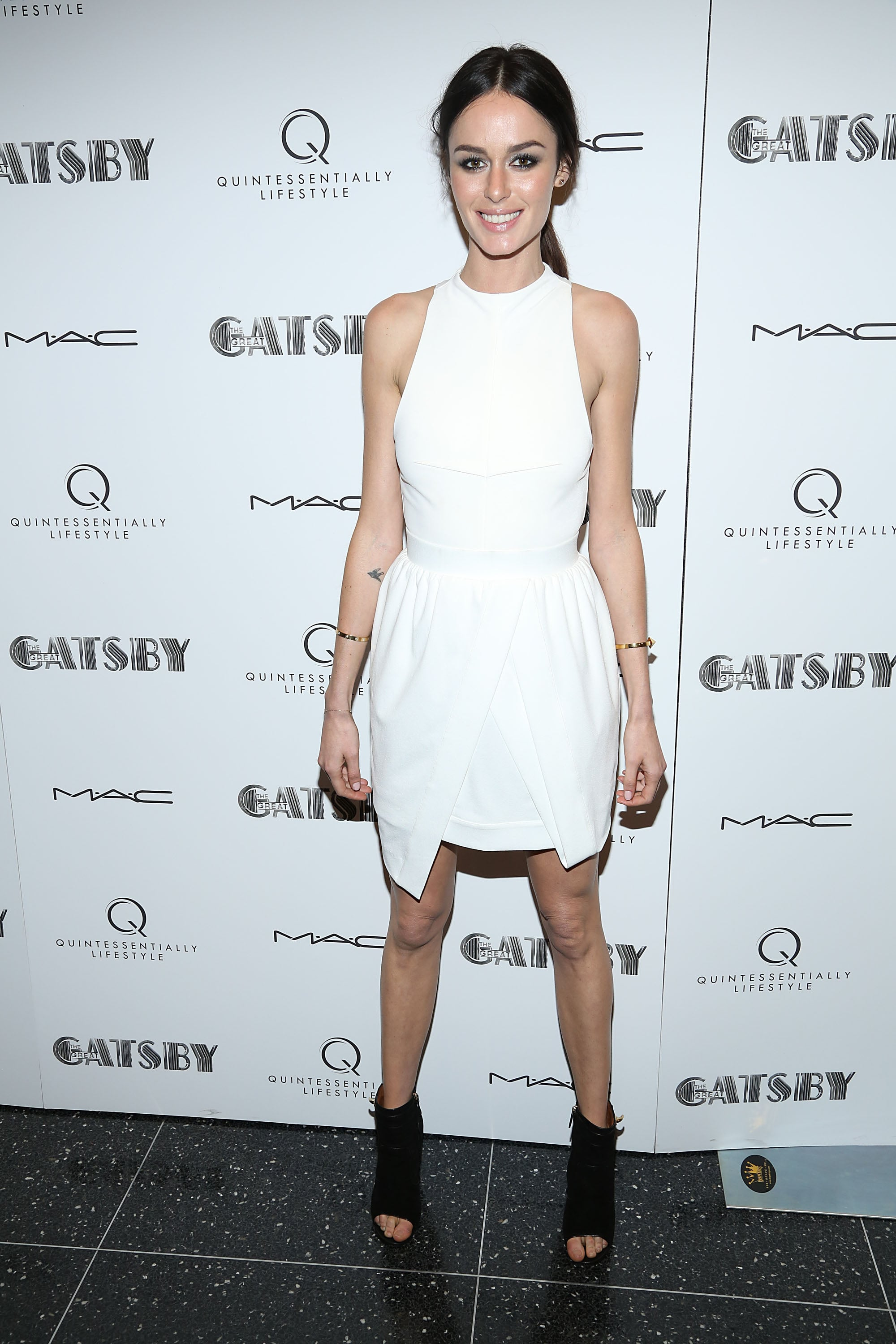 Nicole Trunfio added edge to her LWD with open-toe booties.