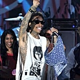 Wiz Khalifa flashed a peace sign at the crowd.