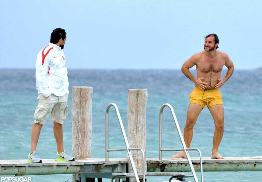 Jude Law wore yellow swim trunks for a swim in the South of France.