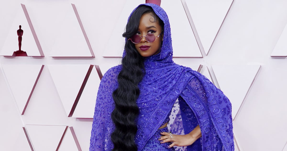 H.E.R.'s Purple Oscars Jumpsuit and Cape May Be an Homage to Prince's 1985 Look