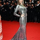 At the All Is Lost premiere at Cannes in 2013, Alessandra Ambrosio struck the fiercest pose she's got in an armor-like silver embellished long-sleeved gown by Roberto Cavalli.
