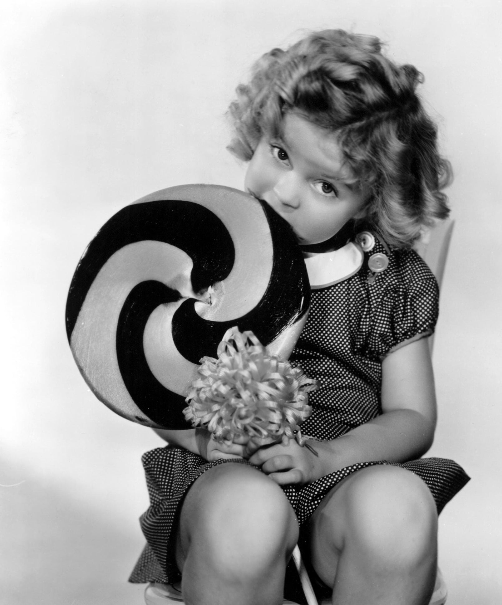 BRIGHT EYES, Shirley Temple, 1934, eating a big lollipop
