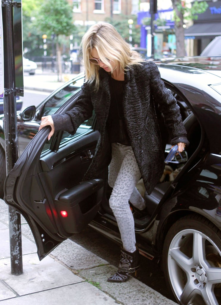 Kate Moss hopped out of a car in London to run an errand.