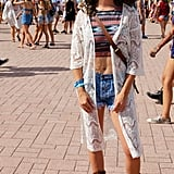 An ikat top and an oversize crocheted vest? She's got the Lolla look down.